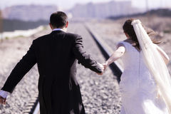 Running just married couple. Unrecognizable just married couple running away Royalty Free Stock Photography