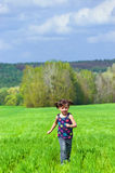 Running kid outdoors Royalty Free Stock Image