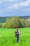 Running kid outdoors Royalty Free Stock Image