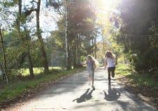 Running kids - girls Stock Photo