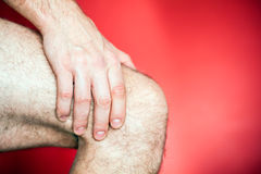 Running knee injury Stock Images