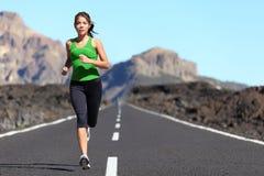 running kvinna för löpare Arkivfoto