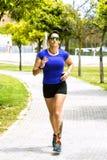 running kvinna för park Royaltyfria Foton