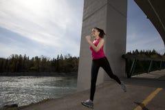 running kvinnabarn Royaltyfri Bild