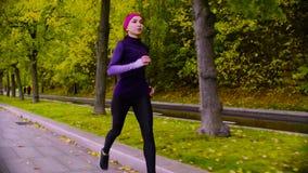 running kvinnabarn för park Höst Kondition lager videofilmer