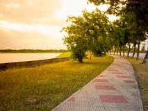 Running lane or walking way for exercise at puplick park river. Running lane or walking way for exercise at public park river side of Ayutthaya Thailand, Sun set Royalty Free Stock Photography