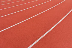 Running lanes. White lines on red asphalt running lanes Stock Photo