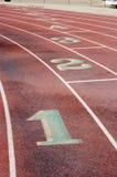 Running Lanes, 4. Lane markings at a wet running track Royalty Free Stock Photos