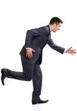 Running late. Young funny caucasian man in suit running, isolated on white Royalty Free Stock Photo