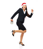 Running late christmas business woman Stock Photography