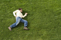 Running laying down on the grass Royalty Free Stock Images
