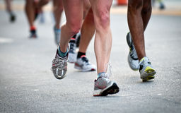 Running legs. Close up of legs while running, use of selective focus Royalty Free Stock Images