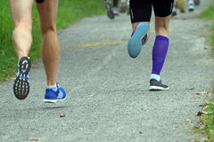 Running legs. Men running at the competition Stock Photography