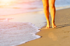 Running legs of runner on beach Stock Photos