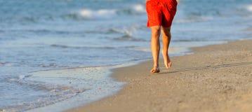 Running legs of runner on beach Royalty Free Stock Image