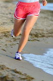 Running legs of runner on beach Royalty Free Stock Images