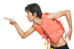 Running lifeguard spotting danger Stock Photos