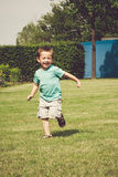 Running little boy Royalty Free Stock Photos