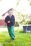 Running little boy Stock Images