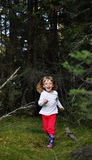 Running little girl in the forest Royalty Free Stock Photos