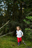 Running little girl in the forest Royalty Free Stock Photo