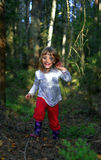 Running little girl in the forest Stock Images