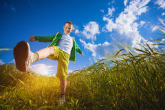 Running little happy boy in the  meadow weat field Stock Images