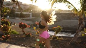 Running long haired woman jogging in park living healthy active lifestyle in summer. Female runner exercising running