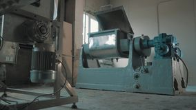 Running machine-tool with open lid at empty bright manufactory. Running grey and blue metal industrial machine-tool with open lid at empty bright manufactory stock video footage