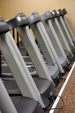 Running Machines. Several running machines in an exercise gym Stock Photos