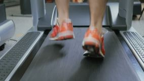 Running male legs in sneakers on the treadmill stock video