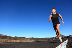 Running - male runner. Running man. Male runner at sprinting speed training for marathon outdoors in amazing volcanic desert landscape. Strong and fit caucasian Royalty Free Stock Image
