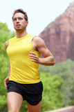Running man. Running fitness man sprinting outdoors in beautiful landscape. Fit male runner training for marathon Royalty Free Stock Photography