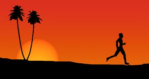 Running man. Silhouette of  a man running on a beach at sunset Royalty Free Stock Photography