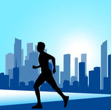 Running man against the city. silhouette of the sprinter Royalty Free Stock Photos