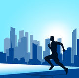 Running man against the city. silhouette of the sprinter Stock Photo