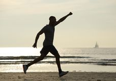 Running man with arm raised in celebration Stock Images