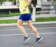 Running man. Athleting young man. Run sportsman.Marathon runners.Sport background.Selective focus. stock photos