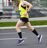 Running man. Athleting young man. Run sportsman. Marathon runners stock photo