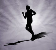 Running man black silhouette on grey background Stock Photos