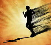 Running man black silhouette on orange background Stock Photography