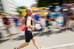 Running man at Bonn Triathlon Stock Images