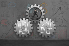 Running man with concrete gears for home and office connection Stock Photography