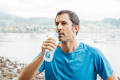 Running man drinking water. After trainning Royalty Free Stock Image