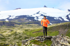 Running man exercising - trail runner athlete. Fit male sport fitness model training and jogging outdoors living healthy lifestyle in beautiful mountain nature royalty free stock photo