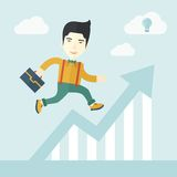 Running man into graph arrow up. A happy chinese career guy running going to a graph arrow up and have a brilliant idea on how to achieve his goal. Business Stock Image
