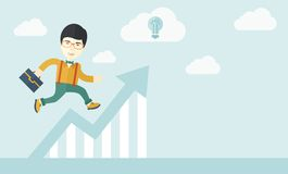 Running man into graph arrow up. A happy chinese career guy running going to a graph arrow up and have a brilliant idea on how to achieve his goal. Business Royalty Free Stock Image