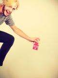 Running man holding keys to house Royalty Free Stock Image