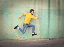 Running. Man is running in jeans Stock Photo