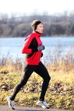 Running man jogging in autumn outdoor Royalty Free Stock Photography